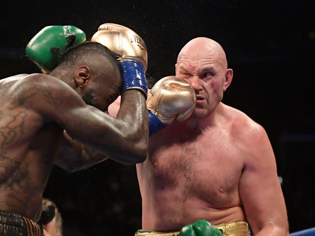 Kein Sieger nach 12 WM-Runden: WBC-Titelhalter Deontay Wilder (links) und Tyson Fury (rechts) werden sich wohl nochmals duellieren (Bild: KEYSTONE/AP/MARK J. TERRILL)