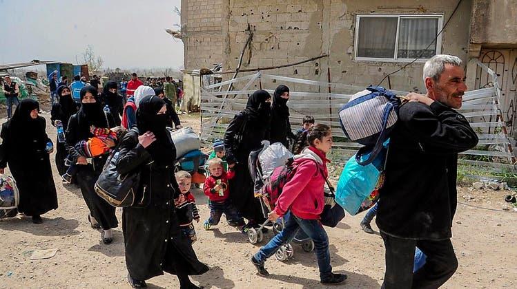 SYRIEN: Letzte Rebellen ziehen aus Ost-Ghuta ab