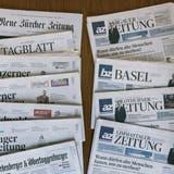 Die Regionalmedien der NZZ-Gruppe sowie deren Online-Portale werden in ein gemeinsames Joint Venture mit den AZ Medien eingeführt. Nicht Teil des Joint Ventures ist die NZZ, ganz oben links. (Bild: Christian Beutler/Keystone)