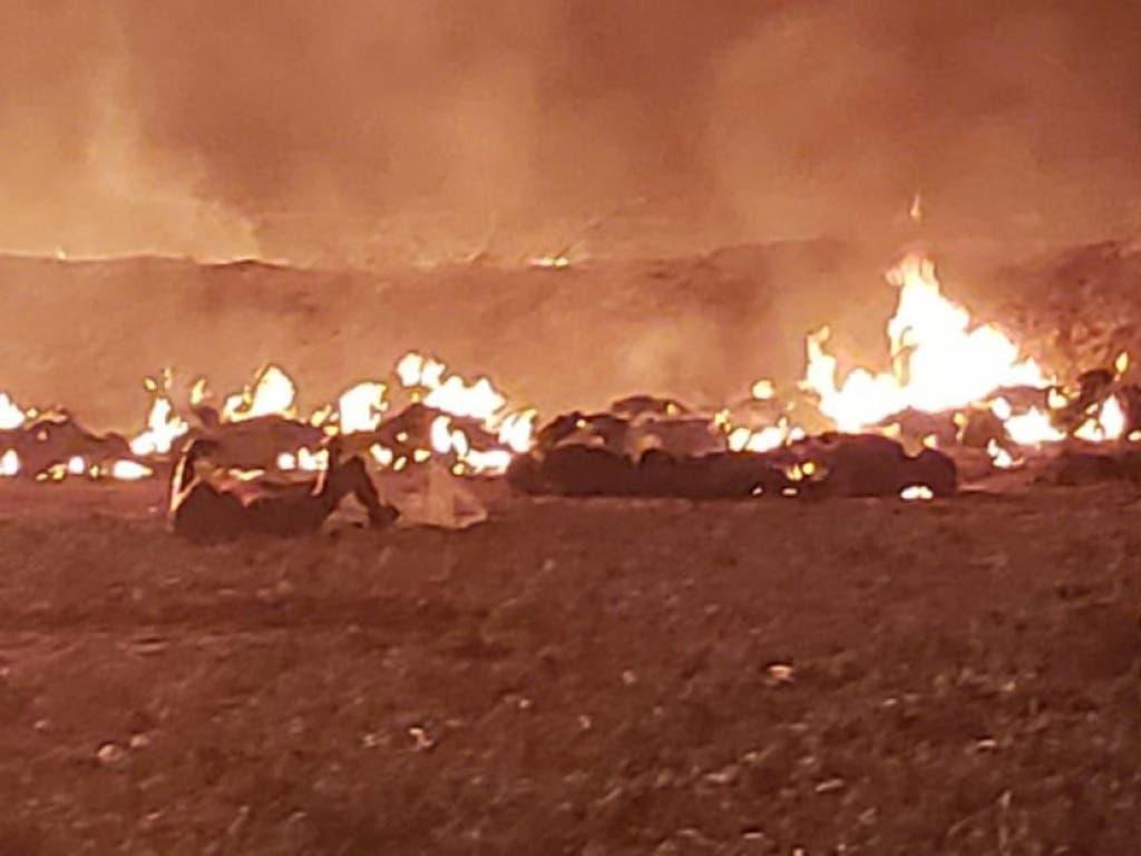 Verbrannte Körper liegen am Boden neben der Benzinpipeline. (Bild: KEYSTONE/EPA REM/STR / REM / HANDOUT)