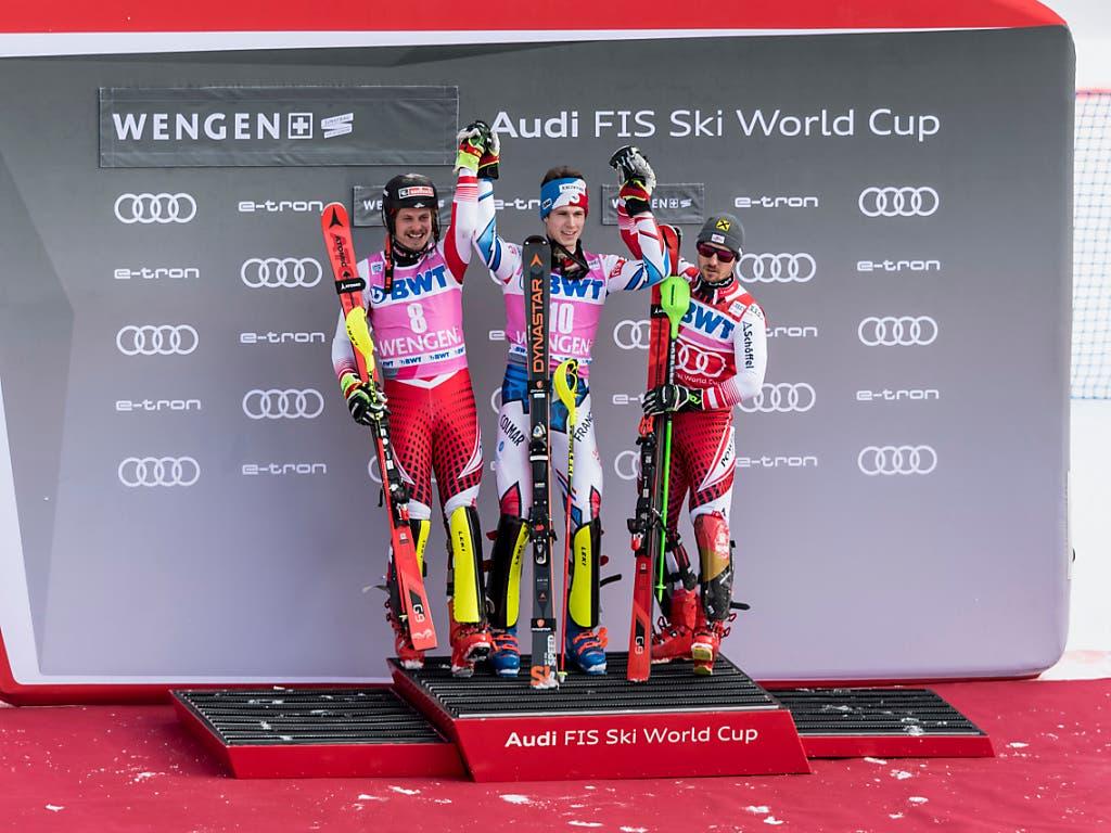 Die ersten drei des Slaloms in Wengen (v.l.): Marcel Hirscher (3.), Clément Noël, Manuel Feller (2.). (Bild: KEYSTONE/ANTHONY ANEX)