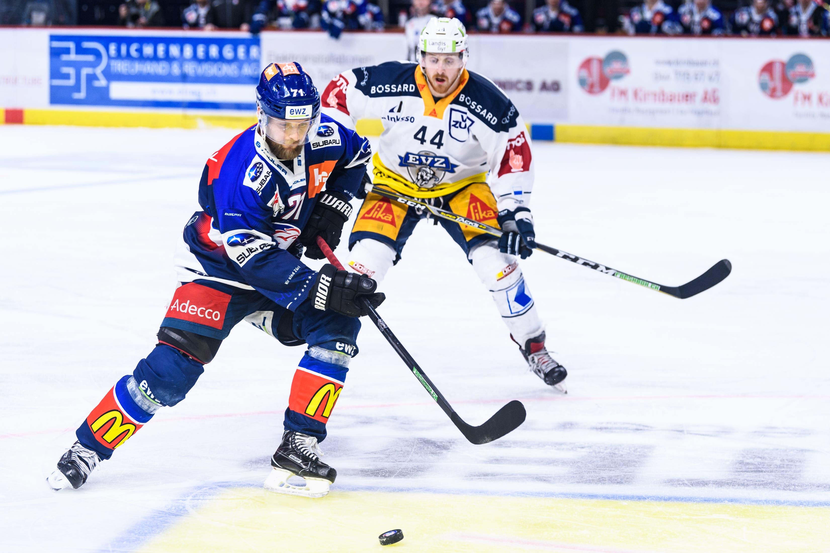 25.01.2019; Zuerich; Eishockey National League - ZSC Lions - EV Zug;Fredrik Pettersson (ZSC) gegen Pontus Widerstroem (Zug) (Vedi Galijas/freshfocus)