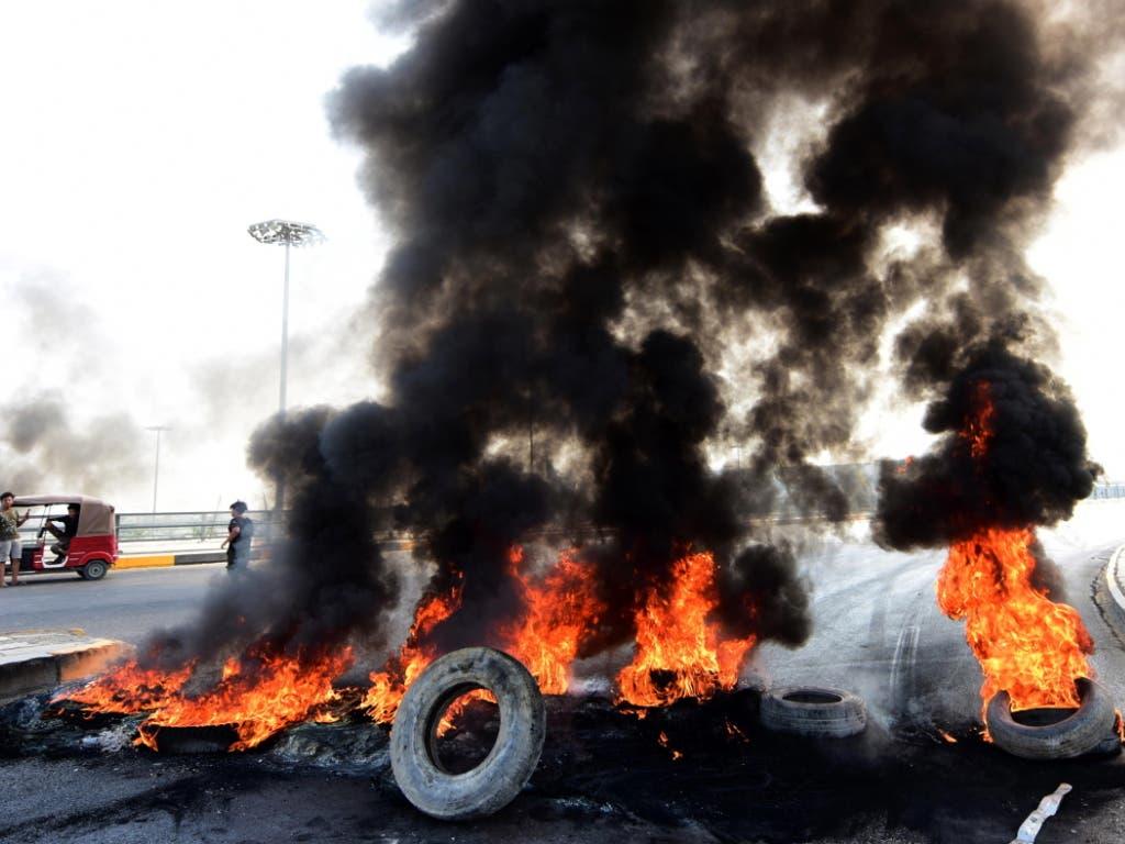 Die Wut der Bürger in den Strassen von Bagdad. (Bild: KEYSTONE/EPA/MURTAJA LATEEF)