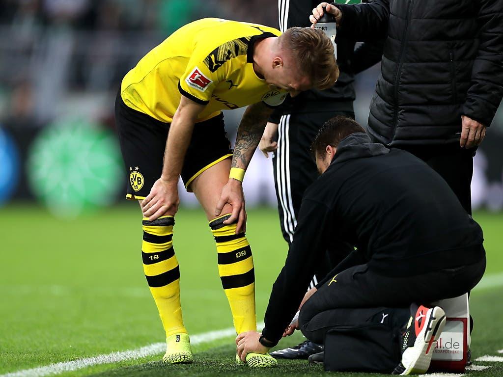 Sein Einsatz ist allerdings fraglich: Captain Marco Reus verletzte sich in der Meisterschaftspartie gegen Wolfsburg am Sprunggelenk (Bild: KEYSTONE/EPA/FRIEDEMANN VOGEL)
