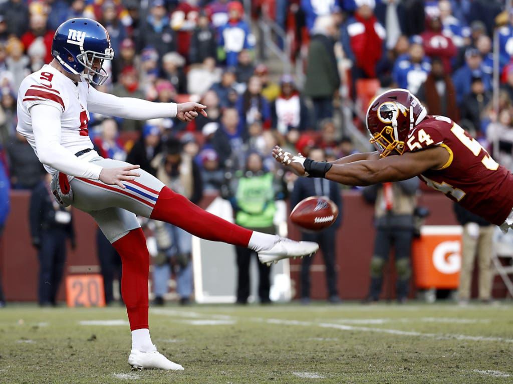 «Wer hier gewinnt, ist in Wirklichkeit der Verlierer», hiess es in der Vorschau. Die New York Giants (li. Punter Riley Dixon) siegten am Sonntag gegen die Washington Redskins (re. Linebacker Nate Orchard)