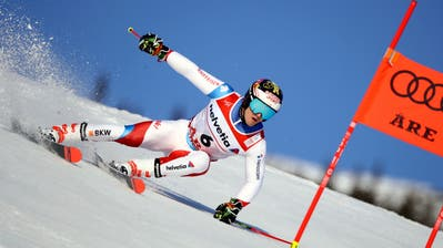 Switzerland's Loic Meillard speeds down the course during the men's giant slalom, at the alpine ski World Championships in Are, Sweden, Friday, Feb. 15, 2019. (AP Photo/Marco Trovati)