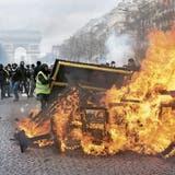 Vergangenen Samstag verwüsteten zahlreiche vermummte Gelbwesten Geschäfte auf den Champs-Elysées. Bild: Getty (Paris, 16. März 2019)