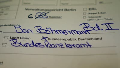 epa07509483 The file relating to the court hearing involving German satirist Jan Boehmermann is placed on the judge's table at the Administrative Court in Berlin, Germany, 16 April 2019. Berlin Administrative Court hears a complaint by Boehmermann who wants to prohibit public statements of German Chancellor Merkel that Boehmermann's 'shame poem' is 'deliberately hurtful' to Turkish President Recep Tayyip Erdogan.  EPA/ALEXANDER BECHER
