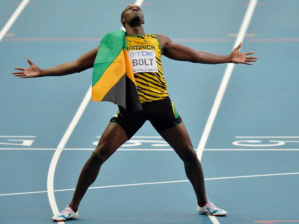 Usain Bolt wirft sich in Pose, hier nach seinem 200-m-Gold 2013 in Moskau. (Bild: KEYSTONE/AP/MARTIN MEISSNER)