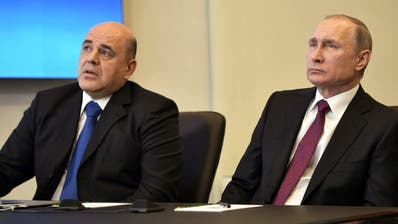 Wladimir Putin (r.) und sein Kandidat für das Amt des Ministerpräsidenten, Michail Mischustin. (Alexey Nikolsky / Sputnik / Krem, EPA)
