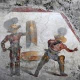 Detailreiches Fresko eines Gladiatorenkampfes in Pompeji entdeckt