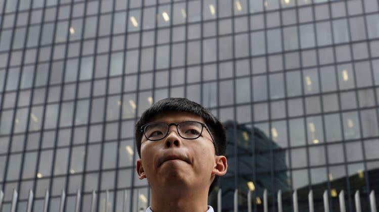 24 und schon am Ende seiner politischen Karriere? Das Regime in Peking will den Hongkonger Demokratie-Aktivisten Joshua Wong ruhigstellen. (Keystone)
