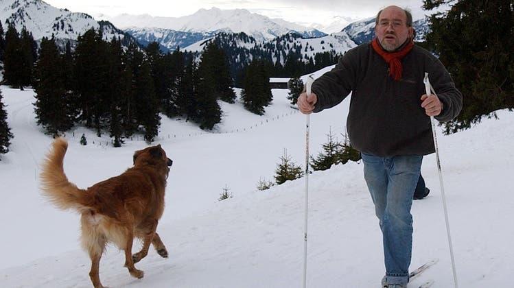 Gesund für Hund und Herrchen: ein Spurt im Schnee. (Keystone)