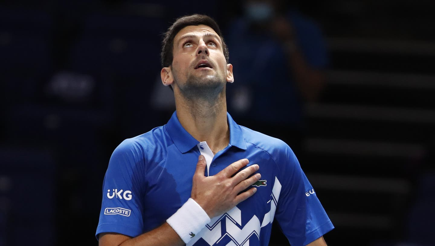 Novak Djokovic of Serbia celebrates winning match point against Alexander Zverev of Germany during their singles tennis match at the ATP World Finals tennis tournament at the O2 arena in London, Friday, Nov. 20, 2020. (AP Photo/Frank Augstein) (Frank Augstein / AP)