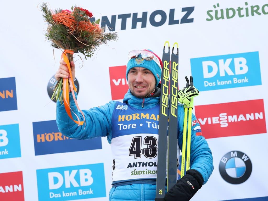 Ein kleines Lächeln, aber für wen? Alexander Loginow, der neue Sprint-Weltmeister im Biathlon, sorgt für Unmut
