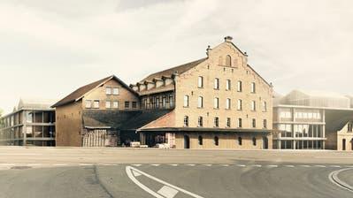 Das markante Hauptgebäude der Ziegelei bleibt bestehen, dahinter entsteht ein Gewerbe- und Wohngebiet. ((Bild: Bühler Hartmann Architektur))
