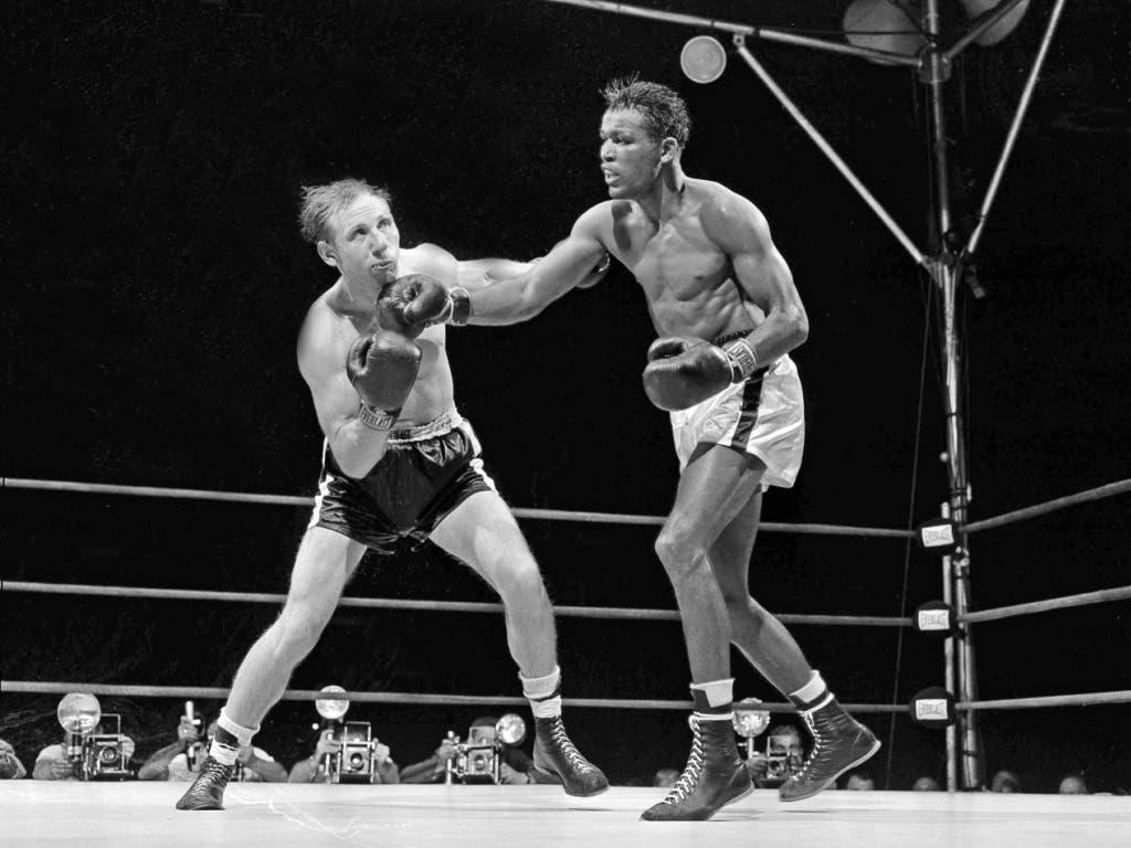 Sugar Ray Robinson (rechts) wurde als Künstler im Ring betitelt. Dieser technisch extrem beschlagene Boxer von grosser Eleganz, wurde in den Vierziger- und Fünfzigerjahren gerade auch für die afroamerikanische Jugend zum Idol und Vorbild
