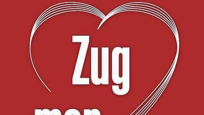 Diese Plakate hängen ab Montagan diversen Orten in Zug.