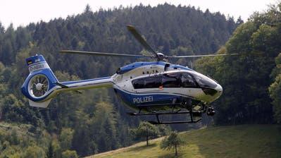 Die Suche der Polizei nach Yves Rausch (links) geht in den Wäldern rund um Oppenau weiter. (Keystone)