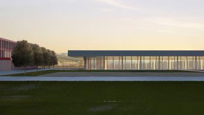 Die neue Turnhalle im Sternmatt II in Baar (rechts) soll teilweise im Untergrund verschwinden. (Bild: Visualisierung Gemeinde Baar)