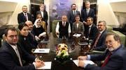 Der türkische Präsident Recep Tayyip Erdogan (Mitte) an Bord seines Flugzeugs. Symbolbild. (Bild: KEYSTONE/AP Pool Turkish Presidency)