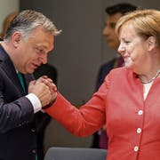 Der ungarische Premierminister Viktor Orbán und die deutsche Kanzlerin Angela Merkel. Bild: Stephanie Lecocq/EPA (Brüssel, 29. Juni 2018)