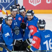 The players from Zug reacts after the 1:1 goal during the Champions Hockey League group D match between Switzerland's EV Zug and Eisbaeren Berlin from Germany, in Zug, Switzerland, Friday, September 7, 2018. (KEYSTONE/Urs Flueeler).