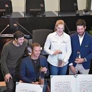 Ruderer Mario Gyr (von links) und die Geehrten: Marcel Hug, Géraldine Ruckstuhl und Michael Schmid. (Bild: Martina Odermatt, 22. Februar 2018)