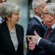 epa07383423 British Prime Minister Theresa May (L) is welcomed by European commission President Jean-Claude Juncker (R) ahead to a meeting on Brexit in Brussels, Belgium, 20 February 2019. May is in Brussels to discuss Brexit and related issues. EPA/STEPHANIE LECOCQ
