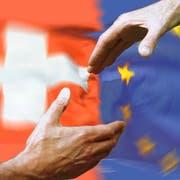 Staatsverträge, etwa zwischen der Schweiz und der EU, sollen künftig automatisch vors Volk, wenn sie aufgrund ihrer Bedeutung auf der gleichen Stufe wie die Bundesverfassung stehen. (Fotomontage: Key (30. November 2004))