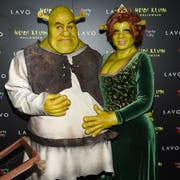 Ihre Halloweenparty ist legendär: Heidi Klum (rechts) und ihr Freund Tom Kaulitz haben sich für die 19. Ausgabe in New York in Shrek und Prinzessin Fiona verwandelt. (Bild: Evan Agostini/Invision/AP (New York, 31. Oktober 2018))