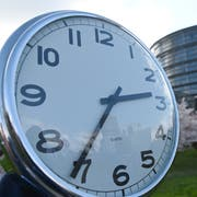 epa07464171 A clock is held next to the European Parliament in Strasbourg, France, 26 March 2019. The plenary will adopt its position on a proposal to end EU-wide seasonal time changes in spring and fall from 2021. EPA/PATRICK SEEGER