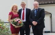 Esther Beerle-Eicher, Pfarrer Thomas Beerle und Kirchgemeindepräsident Michael Berger. (Bild: PD)