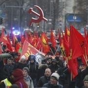 Teilnehmer einer Berliner Demonstration im Gedenken an die beiden 1919 ermordeten Kommunisten Rosa Luxemburg und Karl Liebknecht. (Bild: Michele Tantussi/Getty, 13. Januar 2019)