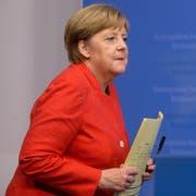 """Merkel sagte, wenn alles umgesetzt werde, sei dies """"mehr als wirkungsgleich"""". (Bild: Stephanie Lecoco / EPA)"""