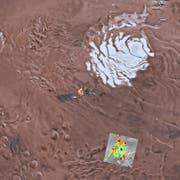 Die Computergrafik zeigt das Ebenengebiet des südlichen Marspols. Die farbig markierten Stellen zeigen einen von Themis (Thermal emission imaging system) untersuchten Bereich. Die dunkelblauen Stellen sollen die Präsenz von flüssigen Wasser zeigen (Bild: Nasa / AP)