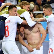 Switzerland's midfielder Xherdan Shaqiri, center, celebrates after scoring the winning goal with teamates Mario Gavranovic, left, Steven Zuber, right, and Michael Lang, center up, during the FIFA World Cup 2018 group E preliminary round soccer match between Switzerland and Serbia at the Arena Baltika Stadium, in Kaliningrad, Russia, Friday, June 22, 2018. (KEYSTONE/Laurent Gillieron)