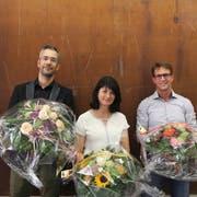Die neuen Gemeinderäte Daniel Widmer und Karin Hollenstein sowie der neue Gemeindepräsident Roger Jung. (Bild: Christine Luley)