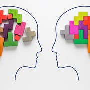 The concept of rational and irrational thinking of two people. Heads of two people with colourful shapes of abstract brain for concept of idea and teamwork. Two people with different thinking.