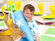 Grosse Zuckertüten am ersten Schultag gehören in Deutschland dazu. (Bild: Getty)