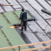 Lohndumping ist unter anderem auf dem Bau ein Problem (Gaetan Bally, Keystone (Zürich, 24. Januar 2013))