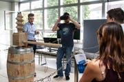 Die NTB hat eine alte Weinpresse über Virtual Reality nachgebildet. Die Besucher können mit einer VR-Brille den Torkel bedienen. (Bild: PD)
