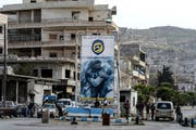Ein Checkpoint von Kämpfern der Syrischen Opposition in der Stadt Idlib. (Bild: Ugur Can/DHA via AP)