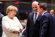 Die deutsche Kanzlerin Angela Merkel, Alain Berset und der Premierminister von Luxemburg Xavier Bettel am Asem-Gipfel. (Bild: EPA/OLIVIER HOSLET)
