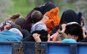 Syrische Flüchtlinge unterwegs an der türkischen Grenze (Bild: PD/AFP/Bulent Kilic)