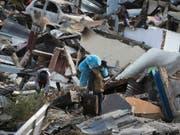 Auf der indonesischen Insel Sulawesi werden nach dem Erdbeben und dem Tsunami noch über 5000 Personen vermisst. (Bild: KEYSTONE/AP/AARON FAVILA)