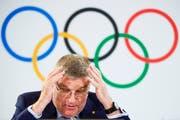 Hat Gegendenwind durch Athletenorganisationen: IOC-Präsident Thomas Bach. (Bild: Valentin Flauraud/Keystone (Lausanne, 20. Juli 2018))