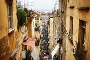 Back alley among the crowded neighborhoods of Naples Italy.
