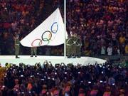Wo wird die olympische Flagge 2026 gehisst werden? (Bild: KEYSTONE/LAURENT GILLIERON)