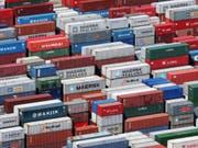 Die Weltwirtschaft steht laut dem IFO-Wirtschaftsklimabarometer vor einer Abkühlung. (Bild: KEYSTONE/AP/MARK LENNIHAN)